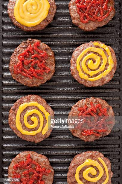 Burgers with mustard and ketchup