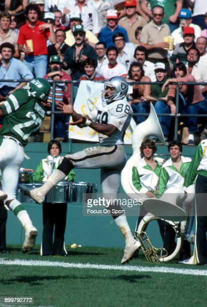 Burgess Owens of the New York Jets breaks up this pass intended for Raymond Chester of the Oakland Raiders during an NFL Football game October 21...