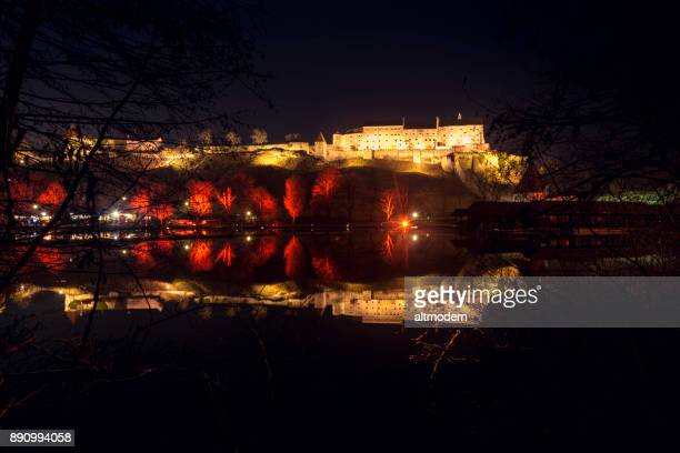 burghausen, germany, bavaria, illuminated castle and woehrsee lake - altötting stock photos and pictures