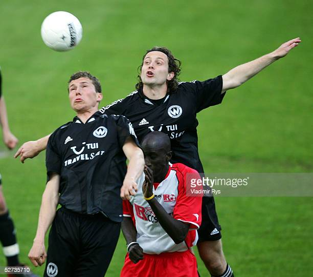 Burghausen's Hrvoje Vukovic Oliver Fink and Babacar N'diaye of Ahlen compete for the ball during the Second Bundesliga match between LR Ahlen and...