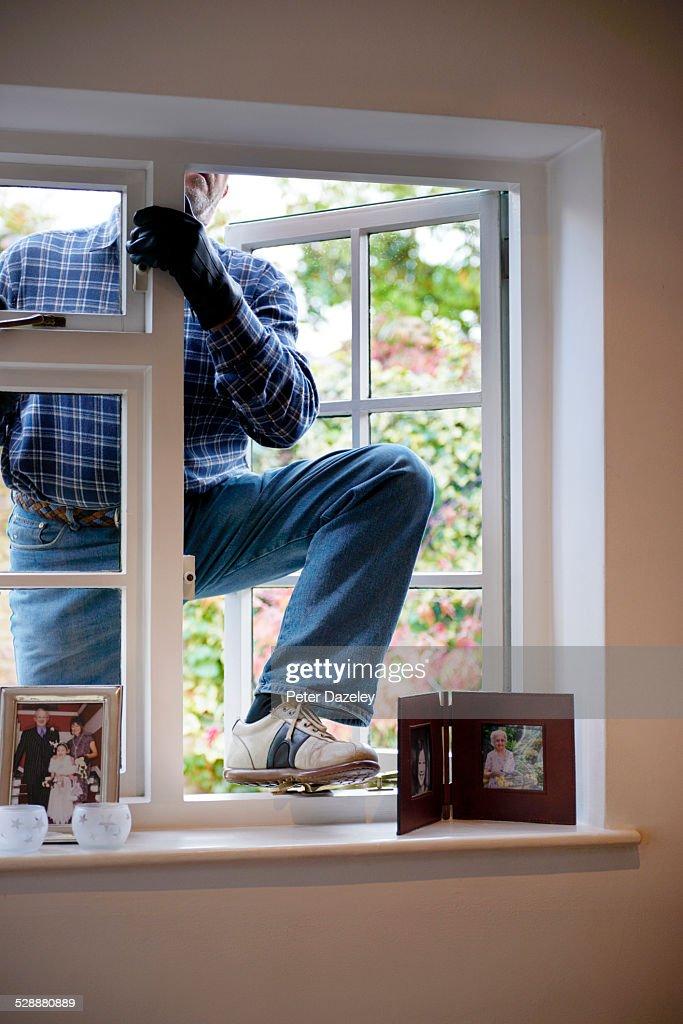 Burglar breaking and entering : Stock Photo