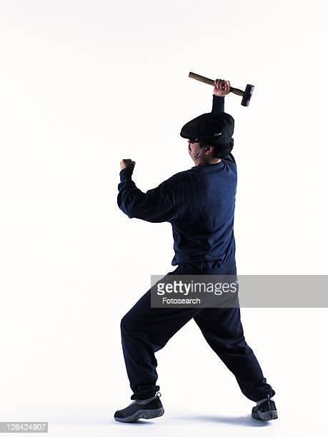 Burglar breaking in, Side View