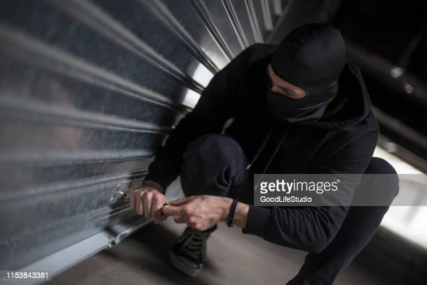 burglar breaking into a garage - looting stock pictures, royalty-free photos & images