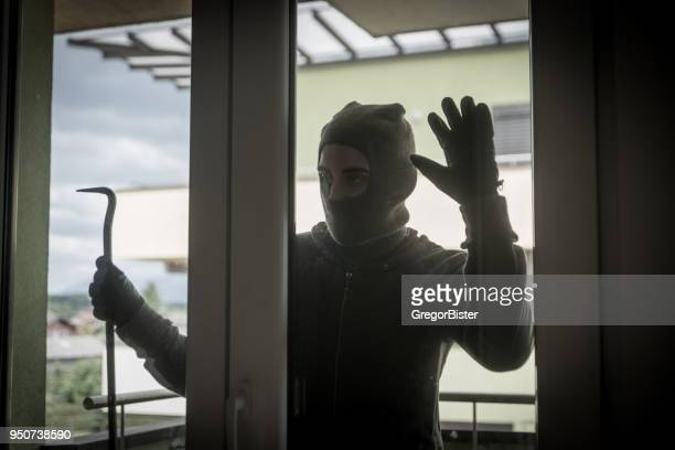 burglar breaking into house - thief stock pictures, royalty-free photos & images