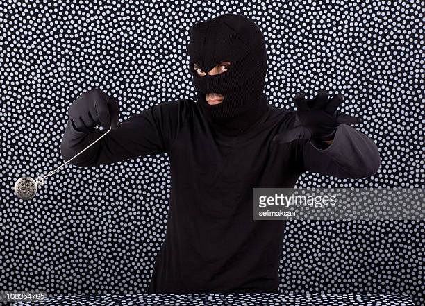 burglar in mask mesmerising via pocket watch - idiots stock pictures, royalty-free photos & images