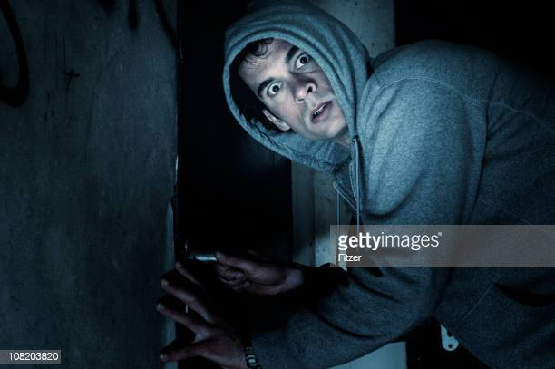 burglar man outside house at night - burglar stock pictures, royalty-free photos & images