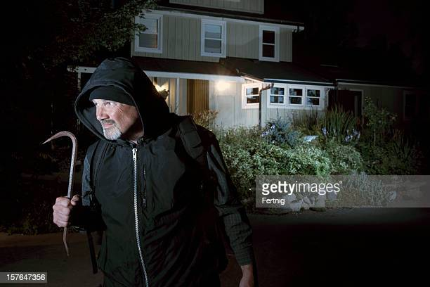 Burglar or criminal scared off by security system