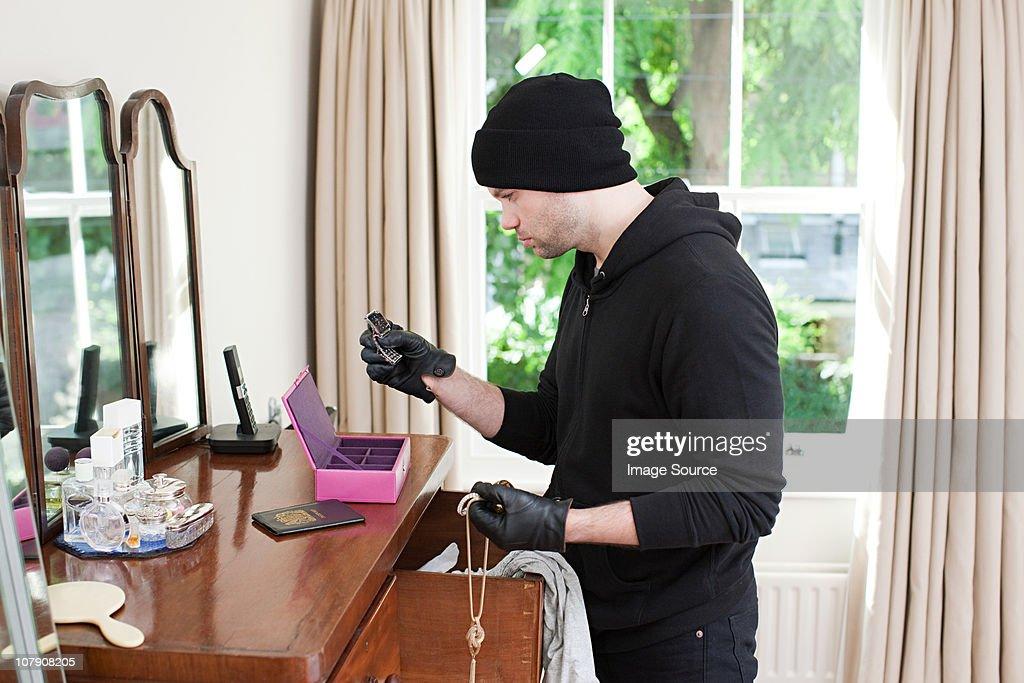 Burglar stealing jewelry : Stock Photo