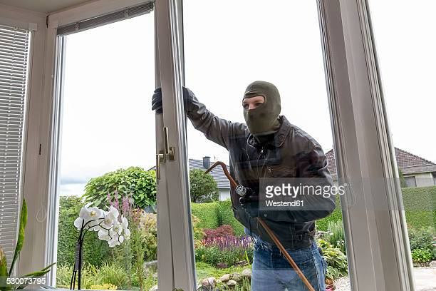 burglar trying to get into house - burglar stock pictures, royalty-free photos & images