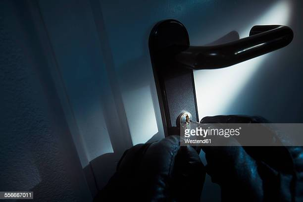 burglar using a picklock at the door - burglar stock pictures, royalty-free photos & images