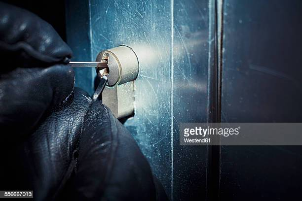 Burglar using a picklock at the door