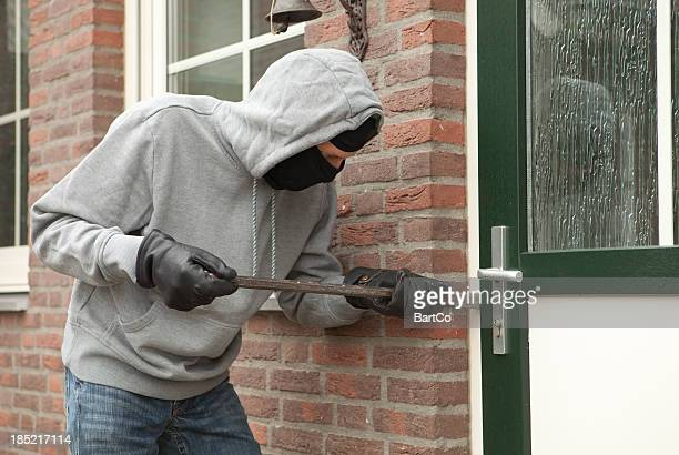 Burglar with crowbar trying to enter house, stealing valuables