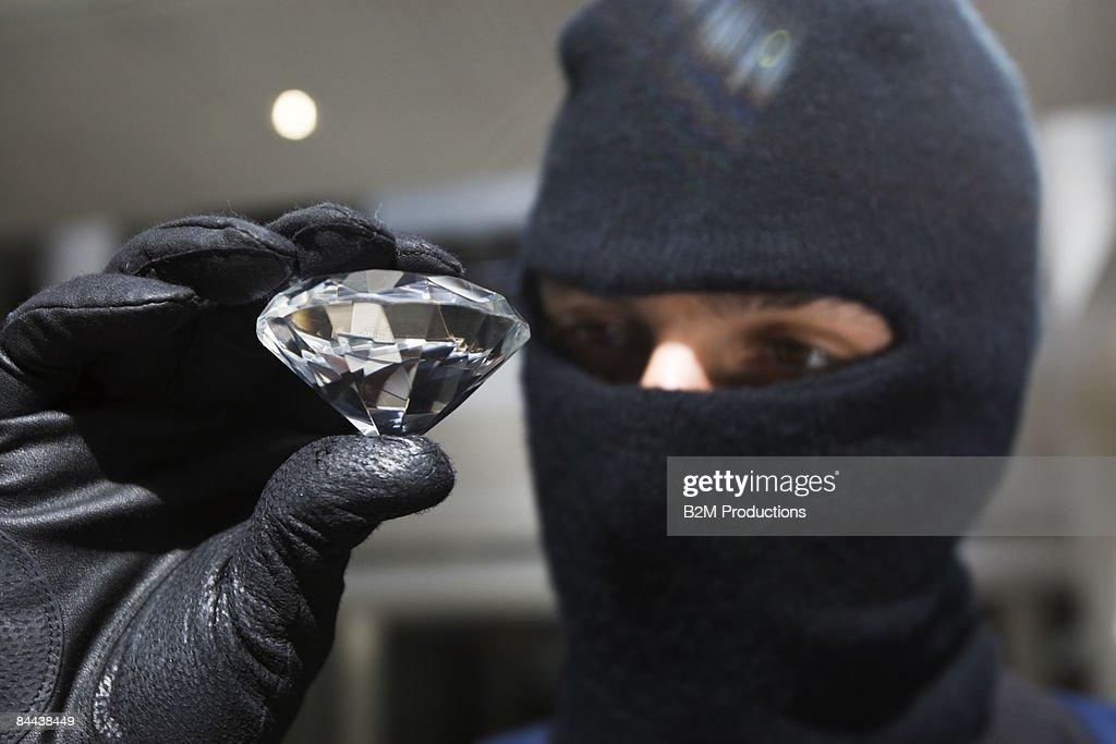 Burglar with diamond : Stock Photo