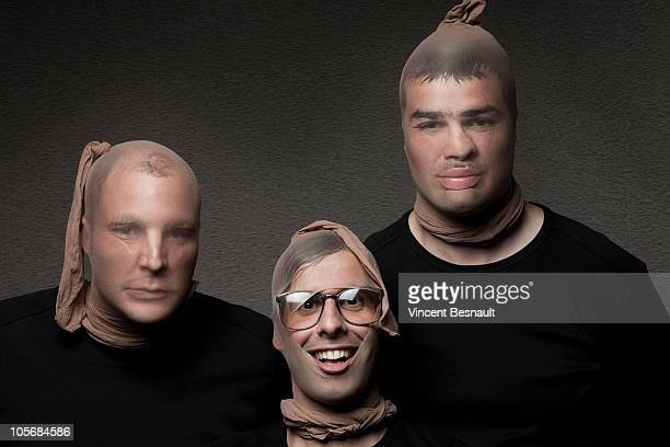 3 burglars with stockings on their heads - men wearing stockings stock photos and pictures