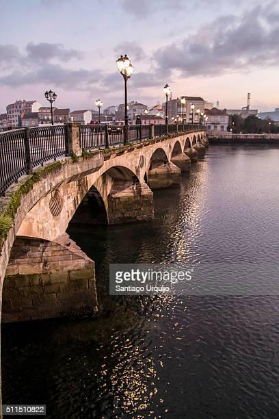 burgo bridge illuminated at sunrise - pontevedra province stock pictures, royalty-free photos & images