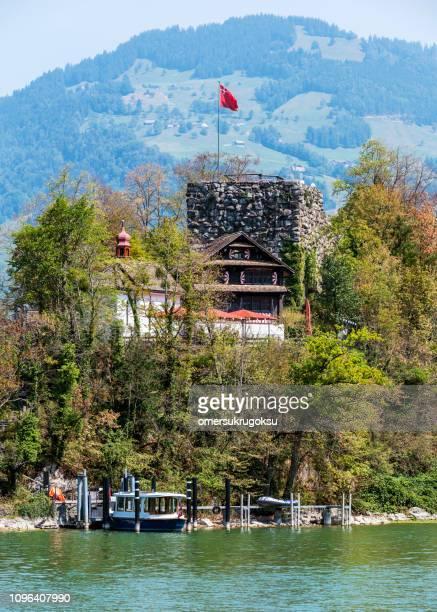 burgruine castle on schwanau island in lake lauerz schwyz, switzerland - schwyz stock pictures, royalty-free photos & images
