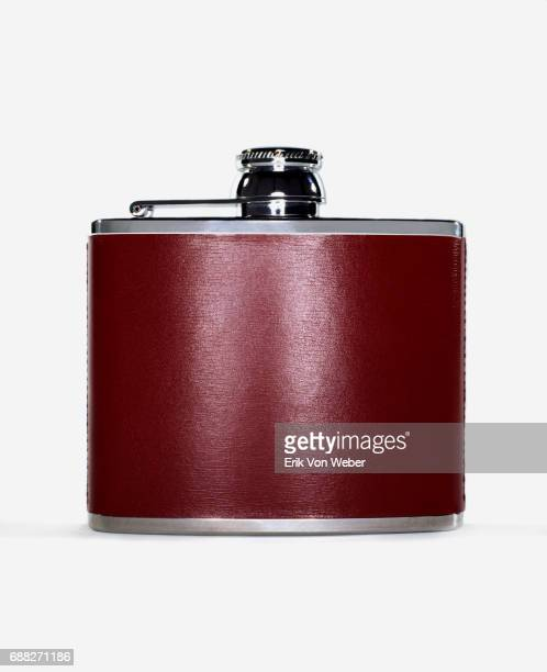 burgundy alcohol flask on white background - flask stock pictures, royalty-free photos & images