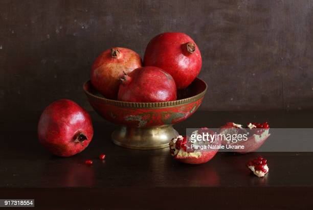 burgundy-red pomegranates - still life stock pictures, royalty-free photos & images