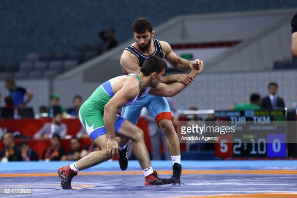 Burhan Akbudak of Turkey competes against Amanaly Atayev of Turkmenistan during the Men's 80kg grecoroman style wrestling match within the 4th...