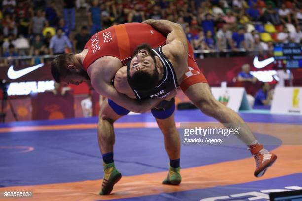 Burhan Akbudak of Turkey in action against Filip Sacic of Croatia during third day of Mens greco roman style 82kg category match within the at the...