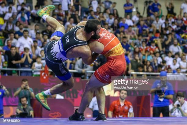 Burhan Akbudak of Turkey in action against Yarosiva Filchakov of Ukraine during the semifinal match at the U23 Senior European Championships in...