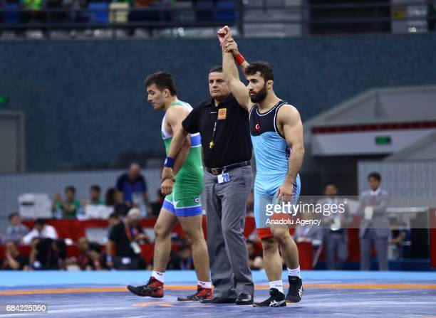 Burhan Akbudak of Turkey wins against Amanaly Atayev of Turkmenistan during the Men's 80kg grecoroman style wrestling match within the 4th Islamic...