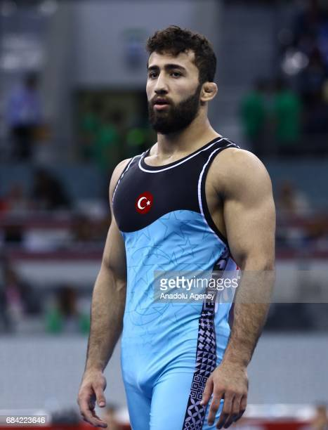 Burhan Akbudak of Turkey wins bronze medal after he won against Amanaly Atayev of Turkmenistan during the Men's 80kg grecoroman style wrestling match...