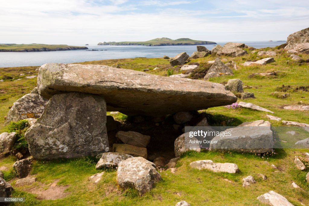 A burial chamber on St Davids Head, Pembrokeshire, Wales, UK, looking towards Ramsey Island. : Stock Photo