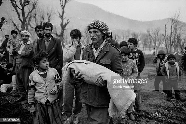 Burial of his youngest child who fell sick during the exodus across the Zagros mountain range whilst fleeing persecution by Saddam Hussein's...