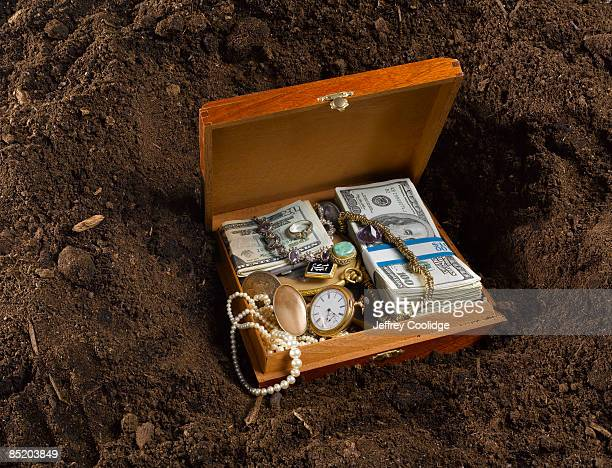 Buried Box with money and jewels
