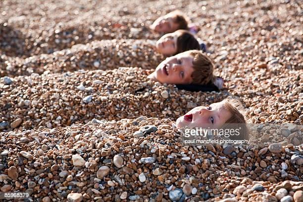 Buried on Brighton beach