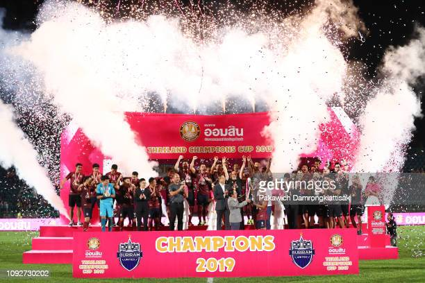 Buriram United players and staff celebrate Omsin Thailand Champions Cup 2019 trophy after the Omsin Thailand Champions Cup match between Buriram...