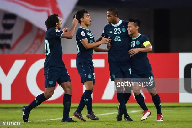 Buriram United players Diogo Luis Santo Ratthanakorn Maikami Edgar and Jakkaphan Kaewprom celebrate a goal during their AFC Champions League group...