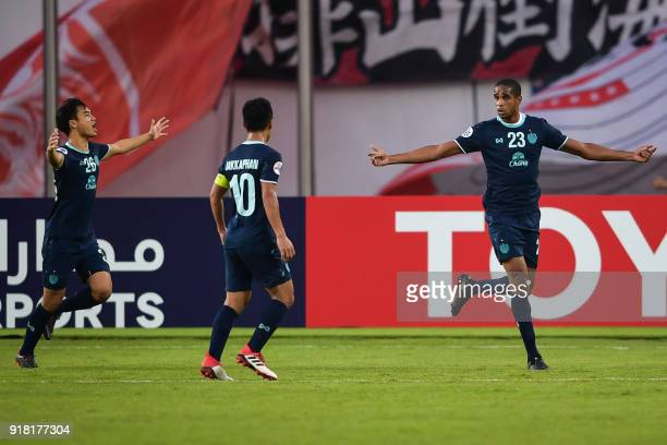 Buriram United players Ratthanakorn Maikami Jakkaphan Kaewprom and Edgar celebrate a goal during their AFC Champions League group stage football...