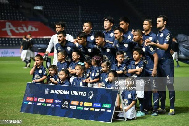 Buriram United pose for a photo before the Thai League 2020 match between Buriram United and Port FC at Buriram Stadium. .