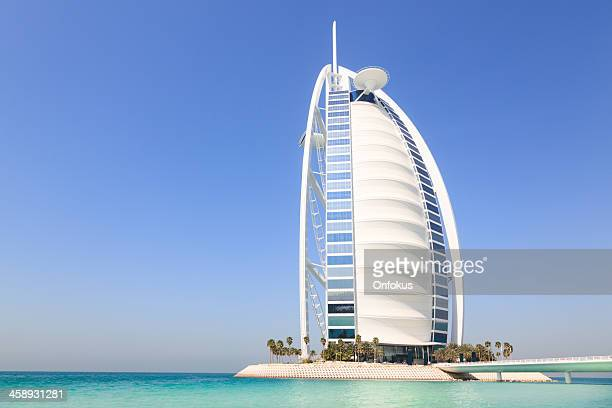 burj al arab hotel with clear blue sky, dubai, uae - jumeirah stock pictures, royalty-free photos & images