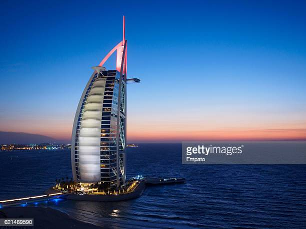 burj al arab jumeirah at night. - international landmark stock pictures, royalty-free photos & images