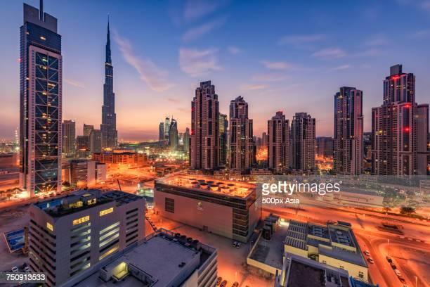 """""""burj khalifa and illuminated skyscrapers at dusk, dubai, united arab emirates"""" - image stock pictures, royalty-free photos & images"""