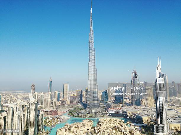 Burj Khalifa In City Against Blue Sky