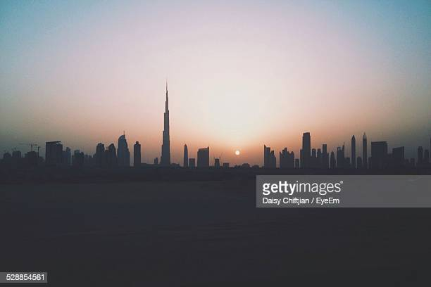 Burj Khalifa With Modern Buildings In City During Sunset