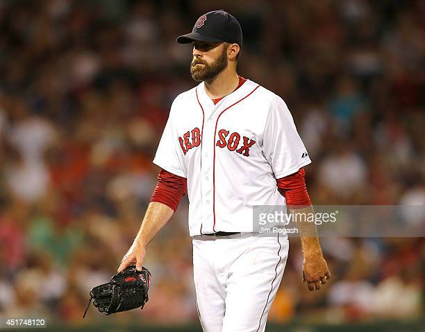 Burke Badenhop of the Boston Red Sox leaves the game in the sixth inning after allowing three runs to score in relief against the Baltimore Orioles...