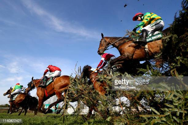 Burke riding RegaL Encore and Davy Russell riding Tiger Roll clear the Canal Turn during the Randox Health Grand National Handicap Chase at Aintree...