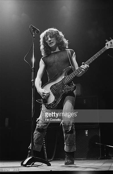 Burke Shelley singer and bassist with British heavy metal band Budgie playing the bass guitar on stage during a live concert performance in London...