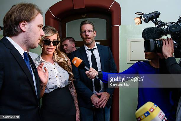 Burkhard Benecken GinaLisa Lohfink and Christian Simonis arrive for a court trial on June 27 2016 in Berlin Germany The 29yearold model was ordered...
