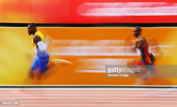 Burkheart Ellis Jr of Barbados and Bradly Toa of Vanuatu compete in the Men's 200 metres heats during the Athletics on day six of the Gold Coast 2018...