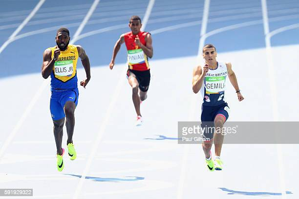 Burkheart Ellis Jr of Barbados Theo Piniau of Papua New Guinea and Adam Gemili of Great Britain compete during the Men's 200m Round 1 on Day 11 of...