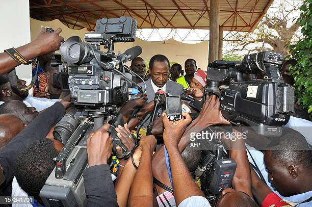 Burkina Faso incumbent President Blaise Compaore speaks with journalists after casting his ballot at a polling station in Ouagadougou during...
