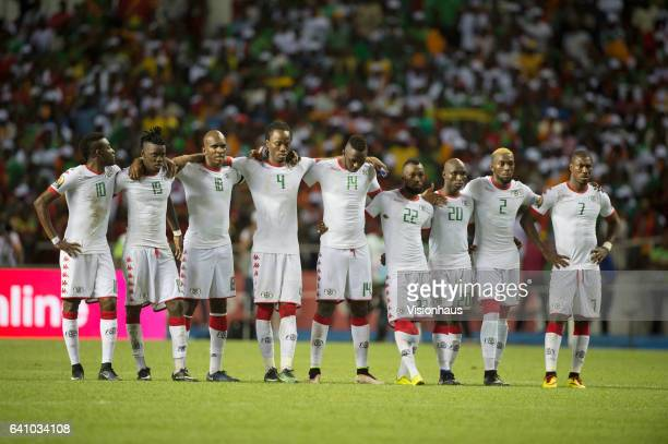 Burkina Faso players watch the penalty shoot out during the semifinal match between Burkina Faso and Egypt at Stade de L'Amitie on February 01 2017...