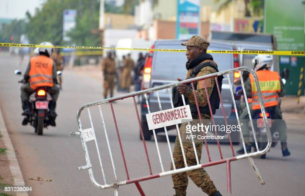 Burkina Faso police establish a barrier on August 14 2017 in Ouagadougou following a deadly attack by gunmen on a restaurant Security forces in the...