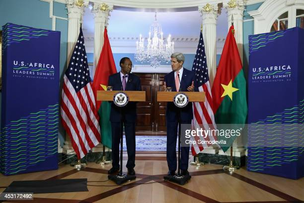 Burkina Faso President Blaise Campaore and U.S. Secretary of State John Kerry deliver brief remarks to the news media before a bilateral meeting...